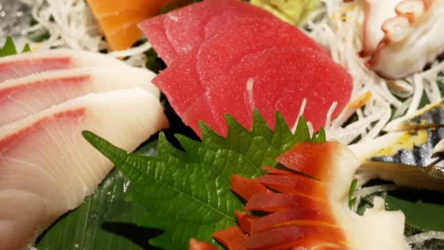 vídeos de stock, filmes e b-roll de sashimi  - sashimi