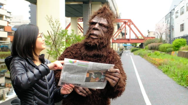 sasquatch in tokyo japan - communication problems stock videos & royalty-free footage