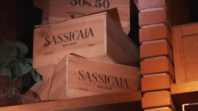 sassicaia bolgheri bottle, italian wine, case of wine - ワインバー点の映像素材/bロール