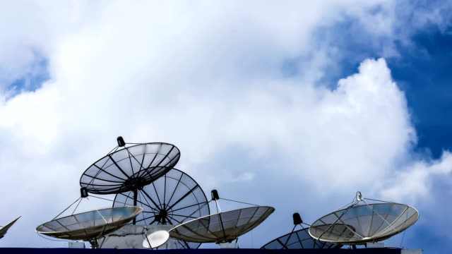 satellite antenna against blue sky - radio controlled handset stock videos and b-roll footage
