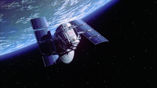 vidéos et rushes de a satellite circles the earth. - satellite