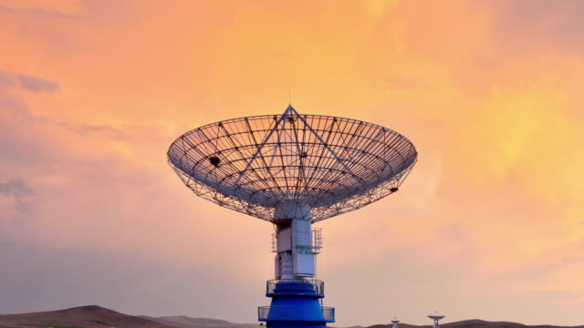 4k: satellite dish communications tower - radio telescope stock videos & royalty-free footage