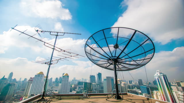 a satellite dish moves in time-lapse - television aerial stock videos and b-roll footage