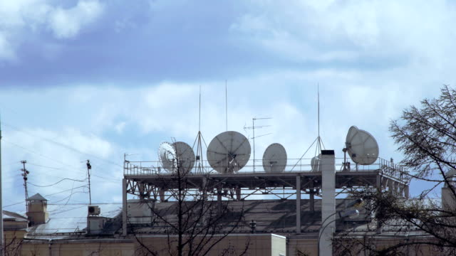 satellite dishes on the rooftop - microwave tower stock videos & royalty-free footage