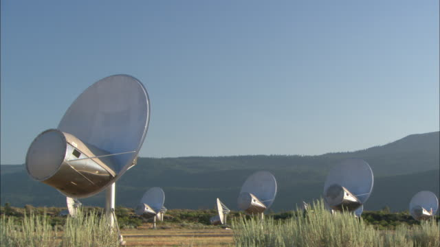vídeos de stock, filmes e b-roll de satellite dishes operate in a field at the usgs in bozeman, montana. - bozeman