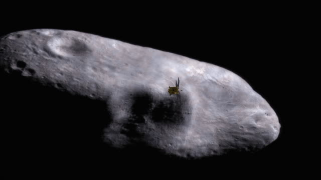 a satellite floats above a large asteroid. - ring stock videos & royalty-free footage