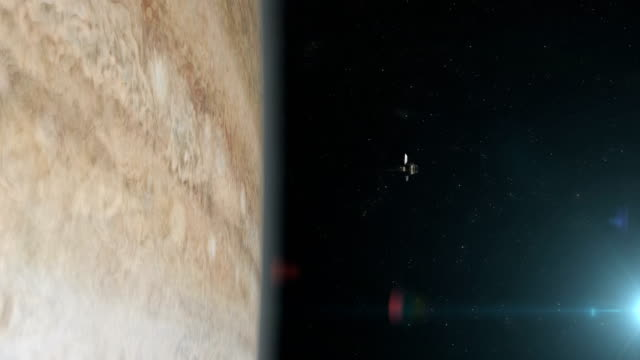 satellite orbiting near jupiter. great red spot. - orbiting stock videos & royalty-free footage