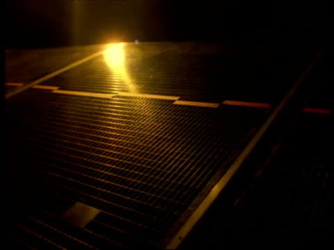 cu satellite panels/wing rotating, reflection of sun setting in panels, golden colouring - infinity stock videos & royalty-free footage