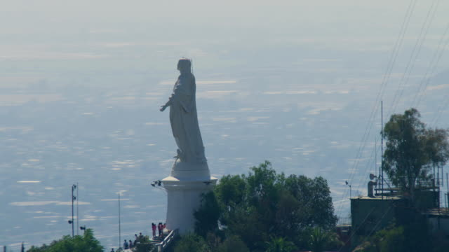 2010 AERIAL Satellite towers around the statue of Virgin Mary on top of Cerro San Cristobal / Santiago de Chile, Gran Santiago, Chile