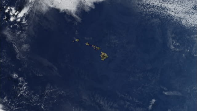 a satellite view of earth travels from the hawaiian islands to south america. - stilla havet bildbanksvideor och videomaterial från bakom kulisserna