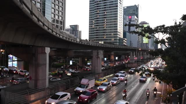 sathon road night traffic, bangkok - bangkok stock videos & royalty-free footage
