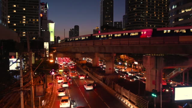 sathon road night traffic, bangkok - bangkok stock videos & royalty-free footage