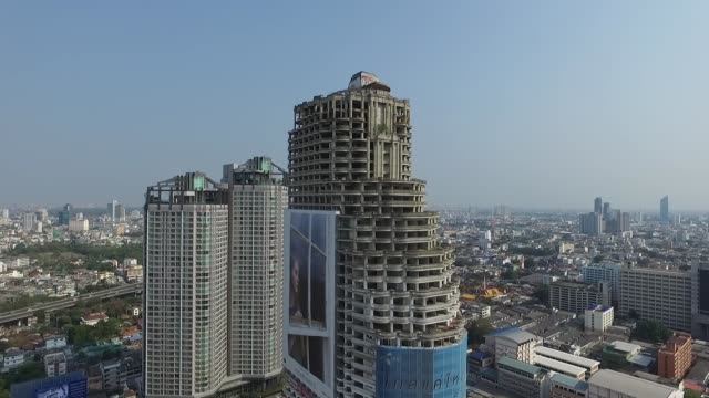 sathorn unique tower is an unfinished skyscraper in the thai capital city of bangkok planned as a highrise condominium complex construction of the... - bangkok stock videos & royalty-free footage