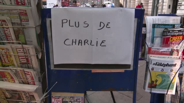 vídeos de stock, filmes e b-roll de satirical magazine charlie hebdo will print five million copies of this week's issue after overwhelming demand saw copies sold out across france... - sátira