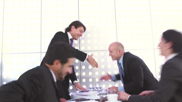 HD: Satisfied Business People Handshaking