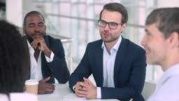 Satisfied caucasian negotiator shake hand of african american partner client