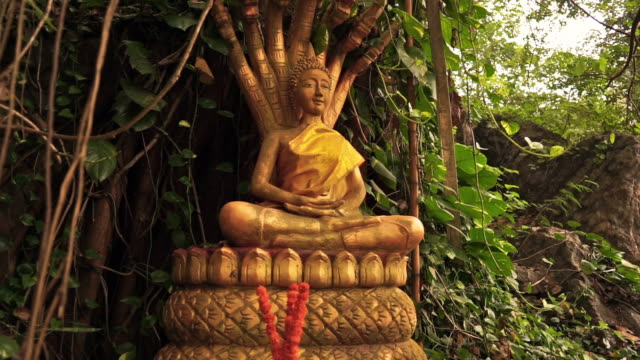 saturday buddha dhyana mudra statue, mount phousi, luang prabang, laos, panning - mudra stock videos & royalty-free footage