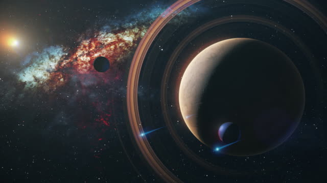 vidéos et rushes de saturne dans l'espace extérieur contre les étoiles et la voie laiteuse - espace texte