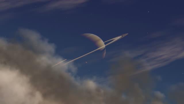 saturn seen through the atmosphere of its moon titan - titan moon stock videos & royalty-free footage