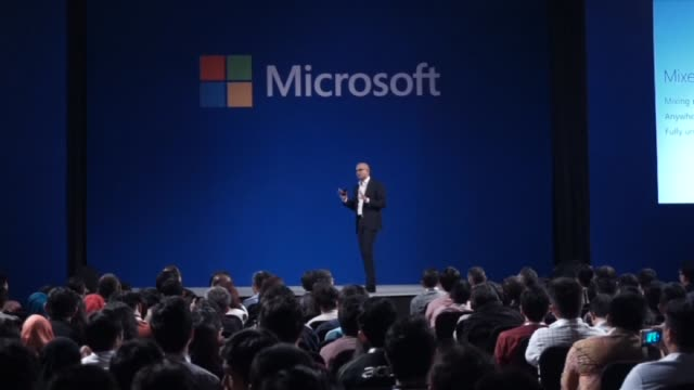 Satya Nadella chief executive officer of Microsoft Corporation talks to an audience during a keynote session at the Microsoft Developer Festival in...