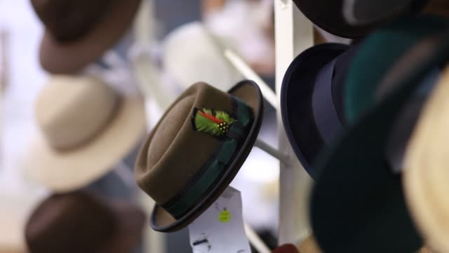 satya twena is a hat designer with a factory located in the fashion district of manhattan on february 24 close up of two hats on display at the satya... - hanging stock videos & royalty-free footage