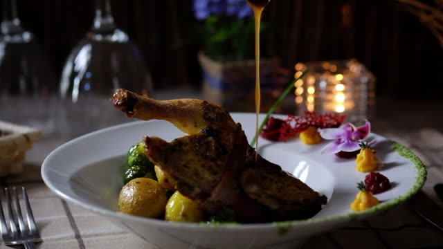sauce pouring to the quail. restaurant dish - brussels sprout stock videos & royalty-free footage