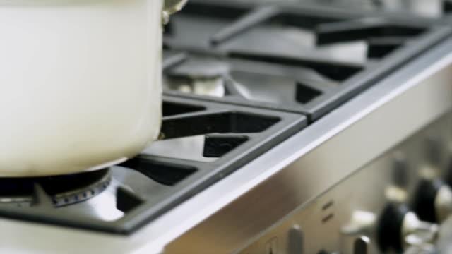 Saucepan boiling on kitchen hob