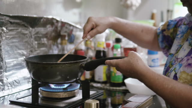 saucepan on fire during cooking - stirring stock videos & royalty-free footage