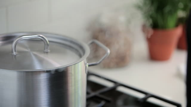saucepan on hob - cooking pan stock videos & royalty-free footage