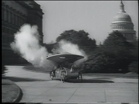 """B/W 1936 PAN """"saucer"""" car on sidewalk starts smoking + burning, driver is pulled out / Washington DC"""
