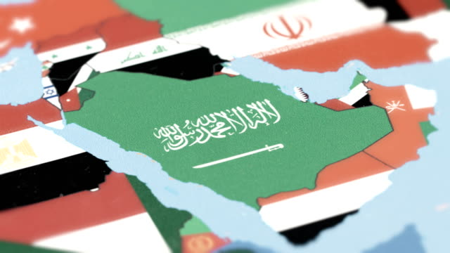 saudi arabia borders wiht national flag on world map - gulf countries stock videos & royalty-free footage
