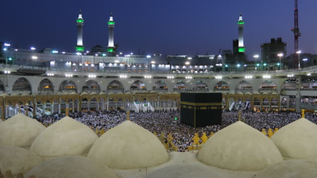 Saudi Arabia. Pilgrims circumambulate seven times to show their submission to the religion