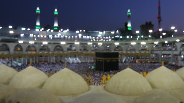Saudi Arabia. Pilgrims circumambulate seven times to show their submission to the religion