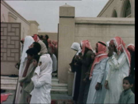 saudi arabia religion; saudi arabia: riyadh: *av mosque pull out to men in for prayer: *gv mosque: *men in: cms shoes lined up - some men remove... - saudi arabia stock videos & royalty-free footage