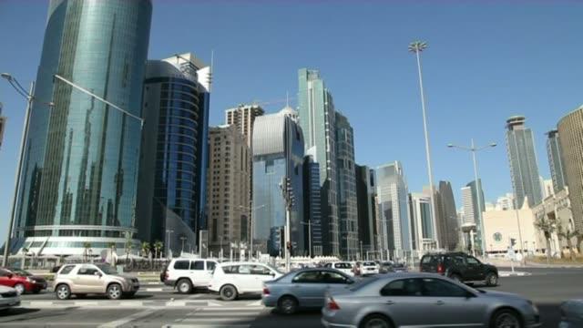 Saudi Arabia tells Qatar to close Al Jazeera television network R04041420 / 442014 EXT Traffic along near skyscrapers in Doha