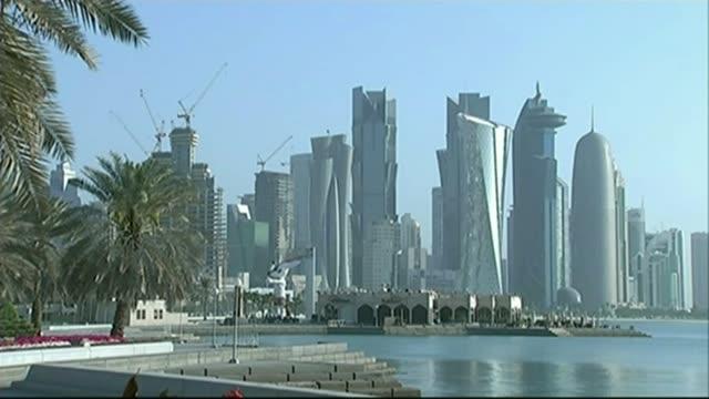 Saudi Arabia tells Qatar to close Al Jazeera television network T24021507 / TX Doha EXT Various shots skyscrapers and high rise buildings END LIB