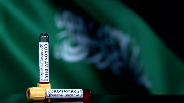 saudi arabian flag flapping behind the blood test tubes - saudi arabia stock videos & royalty-free footage