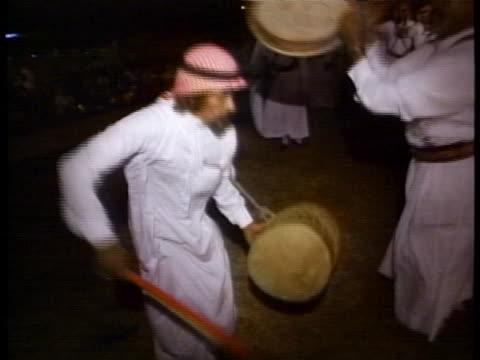 saudi arabian men dance to traditional saudi rhythms. - gulf countries stock videos & royalty-free footage