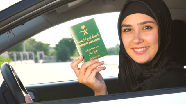 saudi arabian woman is holding her passport in the car - legal system stock videos & royalty-free footage