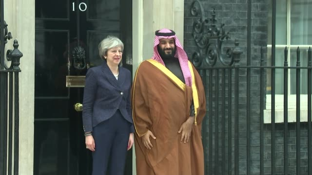 prince mohammed bin salman greeted by queen and protesters england london downing street ext theresa may mp along to shake hands with mohammed bin... - theresa may stock videos & royalty-free footage