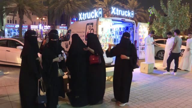 saudi men and women react as the country prepares to lift its decades old women's driving ban - haifa stock videos & royalty-free footage