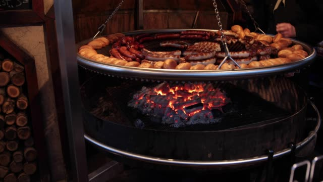 sausages cooking on charcoal fire at  german christmas market - german culture stock videos & royalty-free footage
