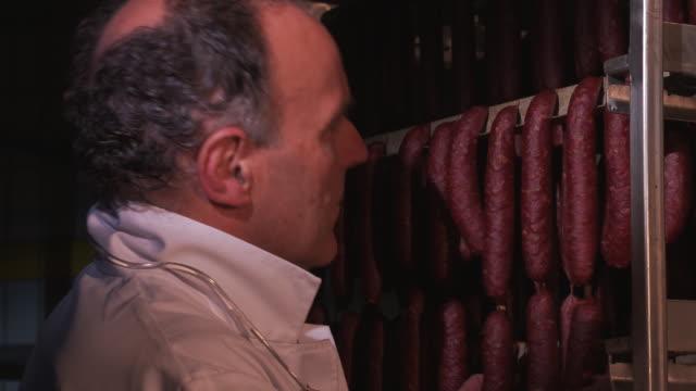 sausages, in the butchery - 収納ラック点の映像素材/bロール