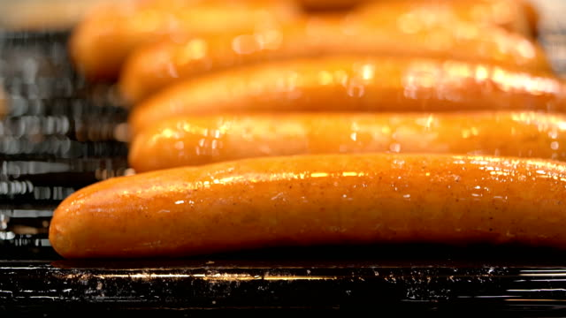 cu sausages on rolling grill - hot dog stock videos & royalty-free footage