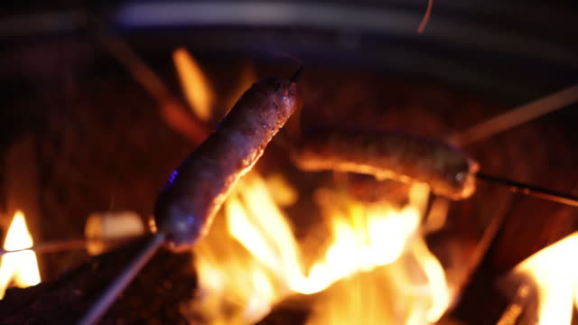 sausages over campfire (extreme close-up) - sausage stock videos & royalty-free footage