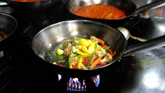 sauté organic vegetables on the stove - roast dinner stock videos & royalty-free footage