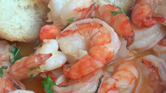 Sauteed Prawns in White Wine Reduced Broth and Toasted Garlic Bread.