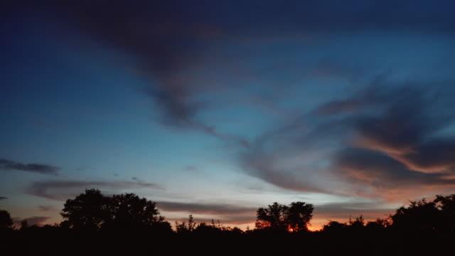 savanna sunrise sky in africa - zambia stock videos & royalty-free footage