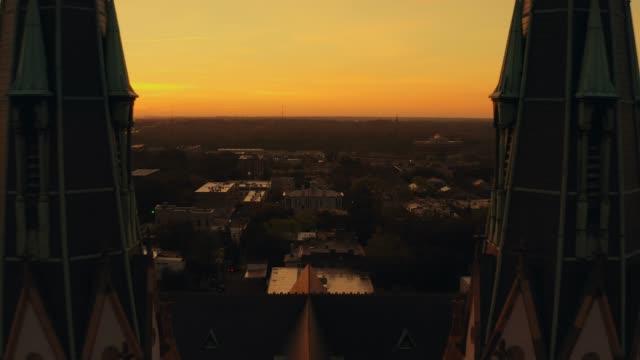 savannah cathedral of st john baptist at sunrise - savannah georgia stock videos & royalty-free footage