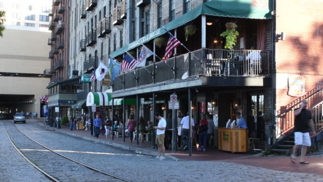 Savannah Georgia River Street tourists at cafes and shops in downtown in heart of city 4K,